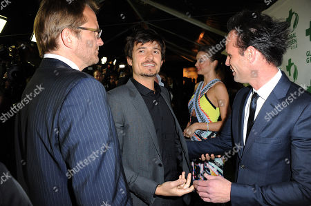 From left, Global Green CEO Matt Petersen, actor Orlando Bloom, model Miranda Kerr and actor Walton Goggins arrive at Global Green USA's 10th Annual Pre-Oscar Party at the Avalon, on in Los Angeles