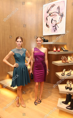 From left, Michelle Box and Brianna Barnes pose during the Halston Heritage boutique opening at Fashion Island, in Newport Beach, Calif