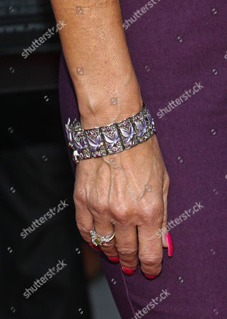 "Producer Suzanne DeLaurentiis (bracelet detail) arrives at the premiere of ""Dark Tourist"" at the ArcLight Cinemas on in Los Angeles"