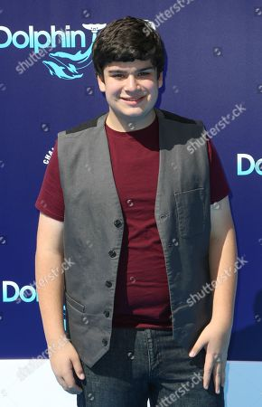 """Devan Leos seen at the LA Premiere of """"Dolphin Tale 2"""" on at Regency Village Theater in Los Angeles, California"""