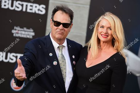 "Dan Aykroyd and Donna Dixon arrive at the Los Angeles premiere of ""Ghostbusters"" at the TCL Chinese Theatre on"