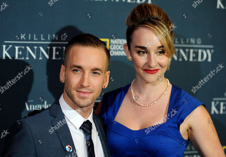 """Stock Picture of Will Rothhaar, left, who plays Lee Harvey Oswald in """"Killing Kenndy,"""" arrives with Ava Vogle at the premiere of the film at the Saban Theatre on in Beverly Hills, Calif"""