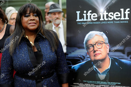 """Chaz Ebert, widow of the late film critic Roger Ebert, poses at the premiere of the documentary film """"Life Itself"""" on in Los Angeles"""