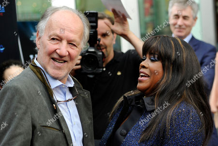 """Director Werner Herzog, left, greets Chaz Ebert, widow of the late film critic Roger Ebert, at the premiere of the documentary film """"Life Itself"""" on in Los Angeles"""