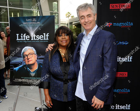 """Chaz Ebert, left, widow of the late film critic Roger Ebert, poses with Steve James, director of the documentary film """"Life Itself,"""" at the premiere of the film on in Los Angeles"""