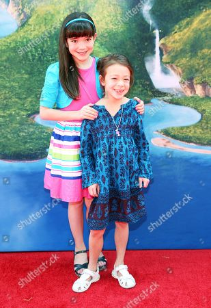 "Chloe Noelle, left, and Aubrey Anderson-Emmons arrive at LA Premiere of ""The Pirate Fairy"", in Burbank, Calif"