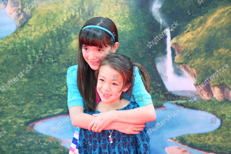 """Chloe Noelle, left, and Aubrey Anderson-Emmons arrive at LA Premiere of """"The Pirate Fairy"""" on in Burbank, Calif"""