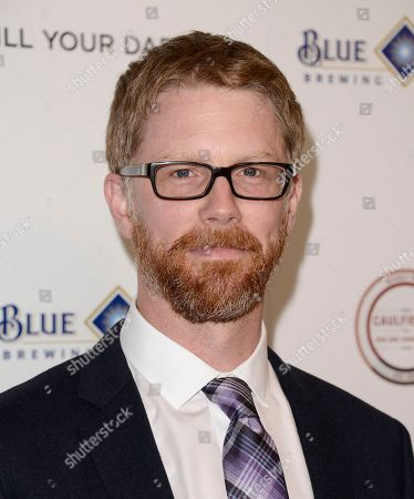 """Stock Picture of Writer Austin Bunn arrives at the premiere of the feature film """"Kill Your Darlings"""" at the Writers Guild of America Theatre on in Beverly Hills, Calif"""