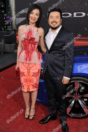 """Sarah Li, left, and Justin Lin arrive at the LA Premiere of the """"Fast & Furious 6"""" at the Gibson Amphitheatre on in Universal City, Calif"""