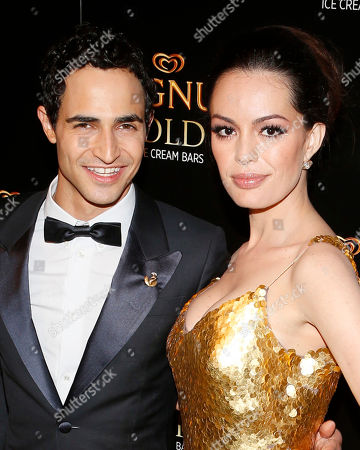 Couture designer Zac Posen, left, and actress Caroline Correa arrive on the gold carpet of the As Good As Gold premiere, a new short film starring Joe Manganiello that celebrates the U.S. arrival of MAGNUM Gold?! Ice Cream. The film debuted during the Tribeca Film Festival in New York. Visit MagnumIceCream.com for more information