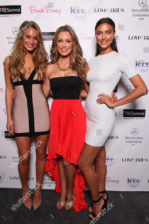 Stock Picture of Model Hannah Davis, designer Angela Chittenden and model Irina Shayk pose backstage before the Beach Bunny Presented By Veet runway show on Day 2 of Mercedes-Benz Fashion Week Swim 2014 at The Raleigh Hotel on in Miami Beach, FL