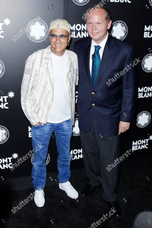 Stock Photo of Chairman of Interscope-Geffen A&M Jimmy Iovine and CEO of Montblanc North America Jan Patrick Schmitz attend Montblanc de la Culture Arts Patronage Award honoring Quincy Jones at Chateau Marmont, in Los Angeles