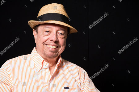 Sergio Mendes poses for a portrait in Los Angeles, Calif. Mendes, 73, has shaped his five-decade career around such unexpected collaborations, performing across genres with musicians from North and South America. He continues on his latest album, Magic, available Tuesday, Sept. 9, 2014, which features contributions by John Legend, will.i.am and Janelle Monae, along with Brazilian artists including Milton Nascimiento and Carlinhos Brown