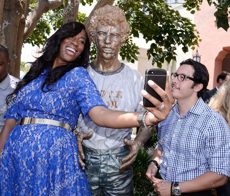 Stock Photo of IMAGE DISTRIBUTED FOR TWENTIETH CENTURY FOX HOME ENTERTAINMENT - Actress Shondrella Avery, left, and actor Efren Ramirez attend the Napoleon Dynamite statue dedication and cast panel discussion on the 20th Century Fox Studios lot in Los Angeles on . Napoleon Dynamite: 10 Sweet Years Edition is available now on Blu-ray and DVD