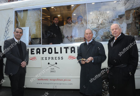 Max Crespo, left, Founder of Neapolitan Express, New York City Mayor Michael Bloomberg, center, and legendary energy executive T. Boone Pickens, right, unveil Neapolitan Express, the first mobile food truck fully-powered by compressed natural gas, at City Hall Park in New York