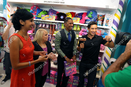 "Mario Lopez, right, interviews Nick Cannon, from right to left, Ross Ellis, founder and CEO of STOMP Out Bullying, and Natasha Madan, Wonka Marketing Manager, as they celebrate NERDS Unite!"", an anti-bullying movement, and present $25,000 to STOMP Out Bullying at Dylan's Candy Bar on in Los Angeles. October is National Bullying Prevention Awareness Month"