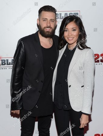 """Stock Photo of Producer Brent Ryan Green and his wife Trang Green attend the premiere of """"23Blast"""" at the Regal Cinemas E-Walk Theater on in New York"""