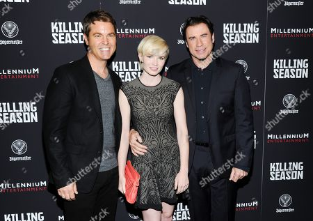 "Director Mark Steven Johnson, left, actress Elizabeth Olin and actor John Travolta attend a special screening of ""Killing Season"" hosted by Jagermeister at the Sunshine Landmark Theater on in New York"