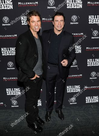 """Director Mark Steven Johnson, left, and actor John Travolta attend a special screening of """"Killing Season"""" hosted by Jagermeister at the Sunshine Landmark Theater on in New York"""