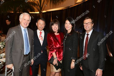 Stock Image of From left, David Grant, General Manager South Coast Plaza; S.L. Huang; Debra Gunn Downing, Executive Director of Marketing for South Coast Plaza; Betty Huang and Alberto Festa, North American President Bulgari pose during a Bulgari benefit dinner for the Pacific Symphony at South Coast Plaza on in Costa Mesa, Calif