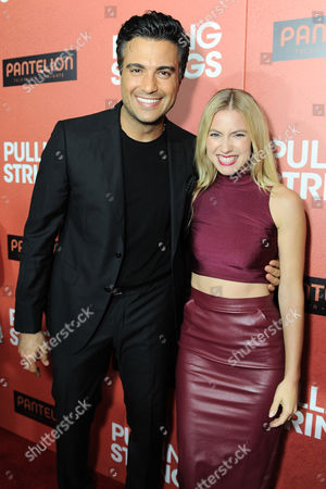 "Jaime Camil, left, and Laura Ramsey arrive at Pantelion Films' ""Pulling Strings"" Los Angeles premiere at Regal Cinemas L.A. Live on in Los Angeles"