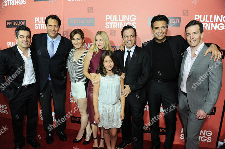 "From left, Omar Chaparro, Pantelion Films CEO Paul Pressburger, Aurora Paile, Laura Ramsey, Renata Ybarra, Pitipol Ybarra, Jaime Camil and Pantelion Films COO Edward Allen arrive at Pantelion Films' ""Pulling Strings"" Los Angeles premiere at Regal Cinemas L.A. Live on in Los Angeles"