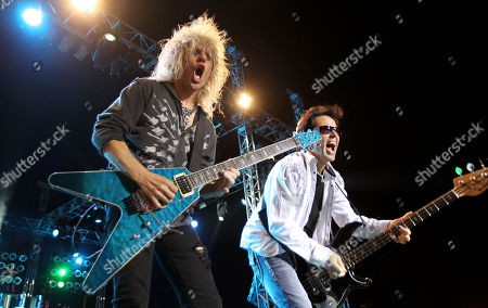 "C.C. DeVille, left, and Bobby Dall perform with the band Poison at the after party for the ""Rock of Ages"" premiere, in Los Angeles"