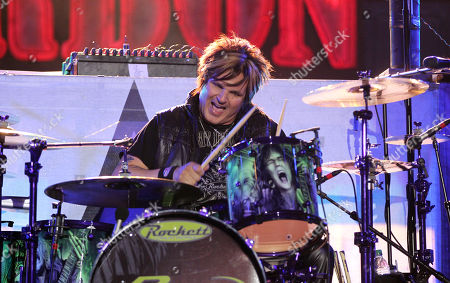 """Rikki Rockett performs with the band Poison at the after party for the """"Rock of Ages"""" premiere, in Los Angeles"""