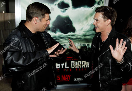 """Writer and producer Oren Peli, left, and cast member Jesse McCartney speak to each other at the premiere of """"Chernobyl Diaries"""" on in Los Angeles"""