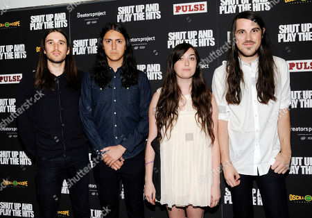 """Members of the band Cults, from left, Marc Deriso, Nathan Aguilar, Madeline Follin and Brian Oblivion attend a special screening of """"Shut Up And Play The Hits"""" at the Village East Theater, in New York"""