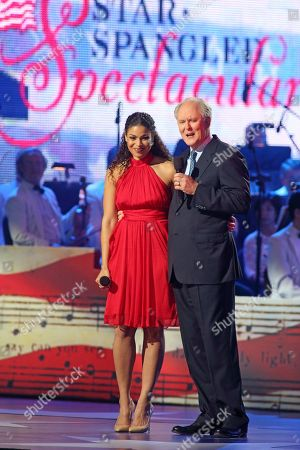 Jordan Sparks, left. and John Lithgow host the Star-Spangled Spectacular Concert: Bicentennial of Our National Anthem at Pier Six Pavilion, in Baltimore