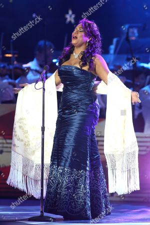 Denyce Graves-Montgomery performs in concert during the Star-Spangled Spectacular: Bicentennial of Our National Anthem Concert at Pier Six Pavilion, in Baltimore