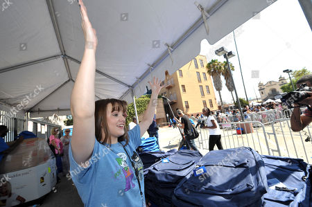 Stock Photo of Starlight StarPower Ambassador Kay Panabaker attends the 2012 FAME Back-To-School event, in Los Angeles. The Starlight Children's Foundation invited families to participate in the event, where participants were given free school supplies and shoes