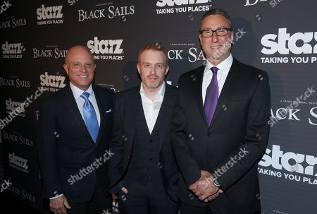 """From left, Chris Albrecht, CEO at Starz, creator Jonathan E. Steinberg, and Carmi Zlotnik, Managing Director at Starz, arrive at the Starz """"Black Sails"""" Premiere on in Los Angeles"""