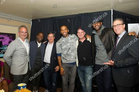 """Michael Thornton, left, Rich Paul, Tom Werner, Maverick Carter, Mike O'Malley, LeBron James and Carmi Zlotnik, right are shown at the Starz screening of """"Survivor's Remorse"""" at the Capitol Theater, in Cleveland, Ohio"""