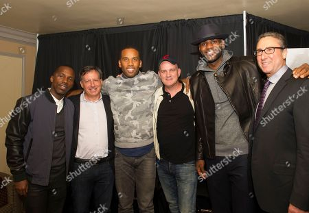 """Rich Paul, left, Tom Werner, Maverick Carter, Mike O'Malley, LeBron James and Carmi Zlotnik, right, are shown at the Starz screening of """"Survivor's Remorse"""" at the Capitol Theater, in Cleveland, Ohio"""