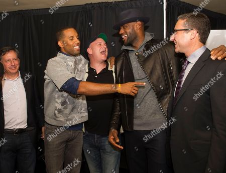 """Tom Werner, left, Maverick Carter, Mike O'Malley, LeBron James and Carmi Zlotnik, right are shown at the Starz screening of """"Survivor's Remorse"""" at the Capitol Theater, in Cleveland, Ohio"""