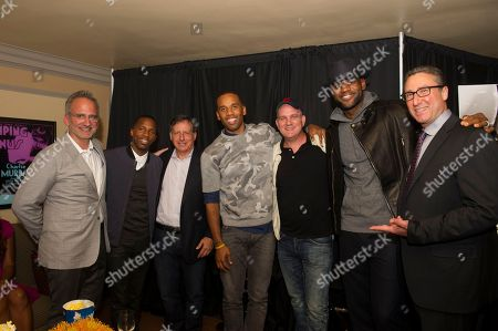 """Michael Thornton, left, Rich Paul, Tom Werner, Maverick Carter, Mike O'Malley, LeBron James and Carmi Zlotnik, right are shown, at the Starz screening of """"Survivor's Remorse"""" at the Capitol Theater, in Cleveland, Ohio"""