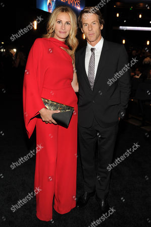 Stock Image of Julia Roberts, left, and Danny Moder pose backstage at the Television Academy's Creative Arts Emmy Awards at the Nokia Theater L.A. LIVE, in Los Angeles