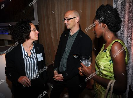 Liz Friedman, and from left, Michael Levine and Victoria Thompson attend the Television Academy's 66th Emmy Awards Writers Nominee Reception on at the Television Academy in the NoHo Arts District of Los Angeles