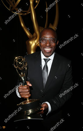 "Stock Photo of EXCLUSIVE - Greg Phillinganes poses backstage with the outstanding music direction award for ""Stevie Wonder: Songs In The Key Of Life - An All-Star GRAMMY Salute"" at the Television Academy's Creative Arts Emmy Awards at Microsoft Theater, in Los Angeles"