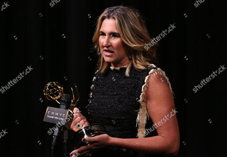 Nancy Dubuc, winner of the Governor's Award, participates in an interview at the Television Academy's Creative Arts Emmy Awards at Microsoft Theater, in Los Angeles