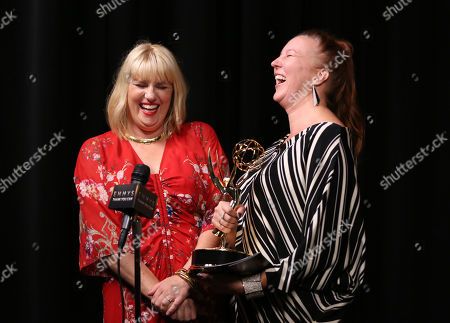 """Marie Schley, left, and Nancy Jarzynko participate in an interview with the outstanding costumes for a contemporary series, limited series or movie for """"Transparent"""" at the Television Academy's Creative Arts Emmy Awards at Microsoft Theater, in Los Angeles"""