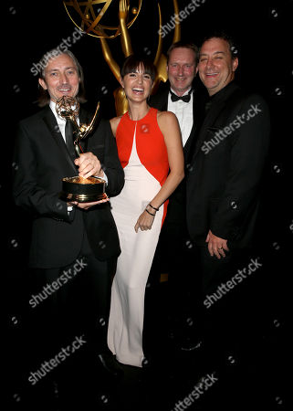 """Ronan Hill, from left, Onnalee Blank, Richard Dyer and Mathew Waters pose backstage with the outstanding sound mixing for a comedy or drama series (one hour) award for """"Game of Thrones"""" at the Television Academy's Creative Arts Emmy Awards at Microsoft Theater, in Los Angeles"""