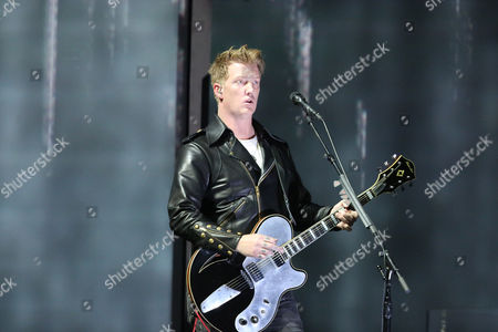 Joshua Homme, of Queens of the Stone Age, performs at the 56th annual Grammy Awards at Staples Center, in Los Angeles