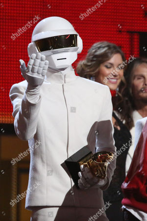 """Thomas Bangalter, of Daft Punk, accepts the award for record of the year for """"Get Lucky"""" at the 56th annual Grammy Awards at Staples Center, in Los Angeles"""
