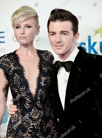 Drake Bell, right, and Paydin Lopachin arrive at The Thirst Project's Annual Gala held at the Beverly Hilton Hotel, in Los Angeles