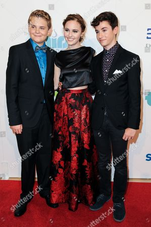 Stock Picture of From left, Reese Hartwig, Ella Wahlestedt, and Teo Halm arrive at The Thirst Project's Annual Gala held at the Beverly Hilton Hotel, in Los Angeles