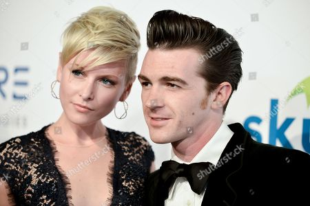 Stock Photo of Drake Bell, right, and Paydin Lopachin arrive at The Thirst Project's Annual Gala held at the Beverly Hilton Hotel, in Los Angeles