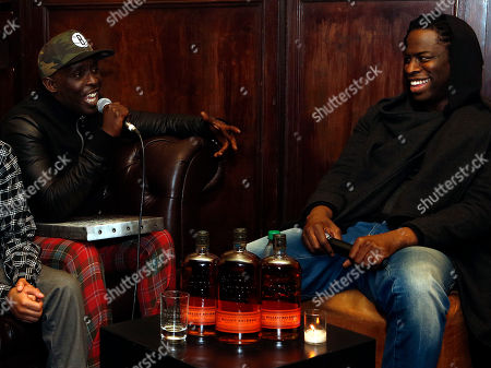 """Actor Michael K. Williams, left, shares a laugh with director Jeymes Samuel during a Q & A session at the Bulleit Bourbon presents """"They Die By Dawn"""" film screening, in New York"""